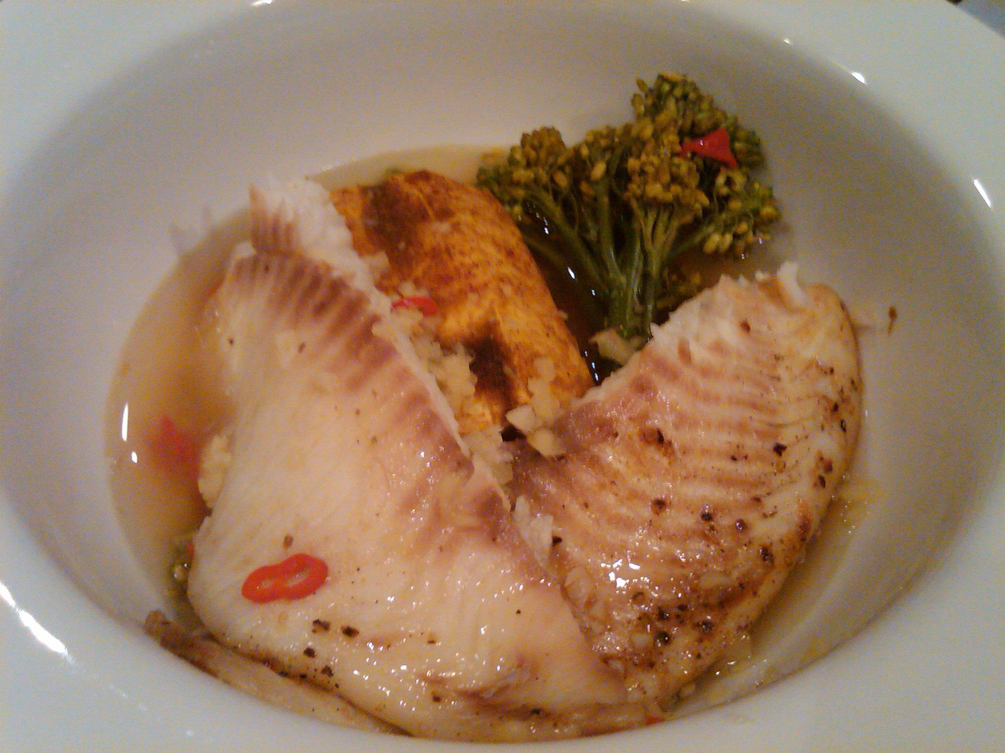 Pan seared tilapia over cinnamon curry plantain in ginger chili broth ...
